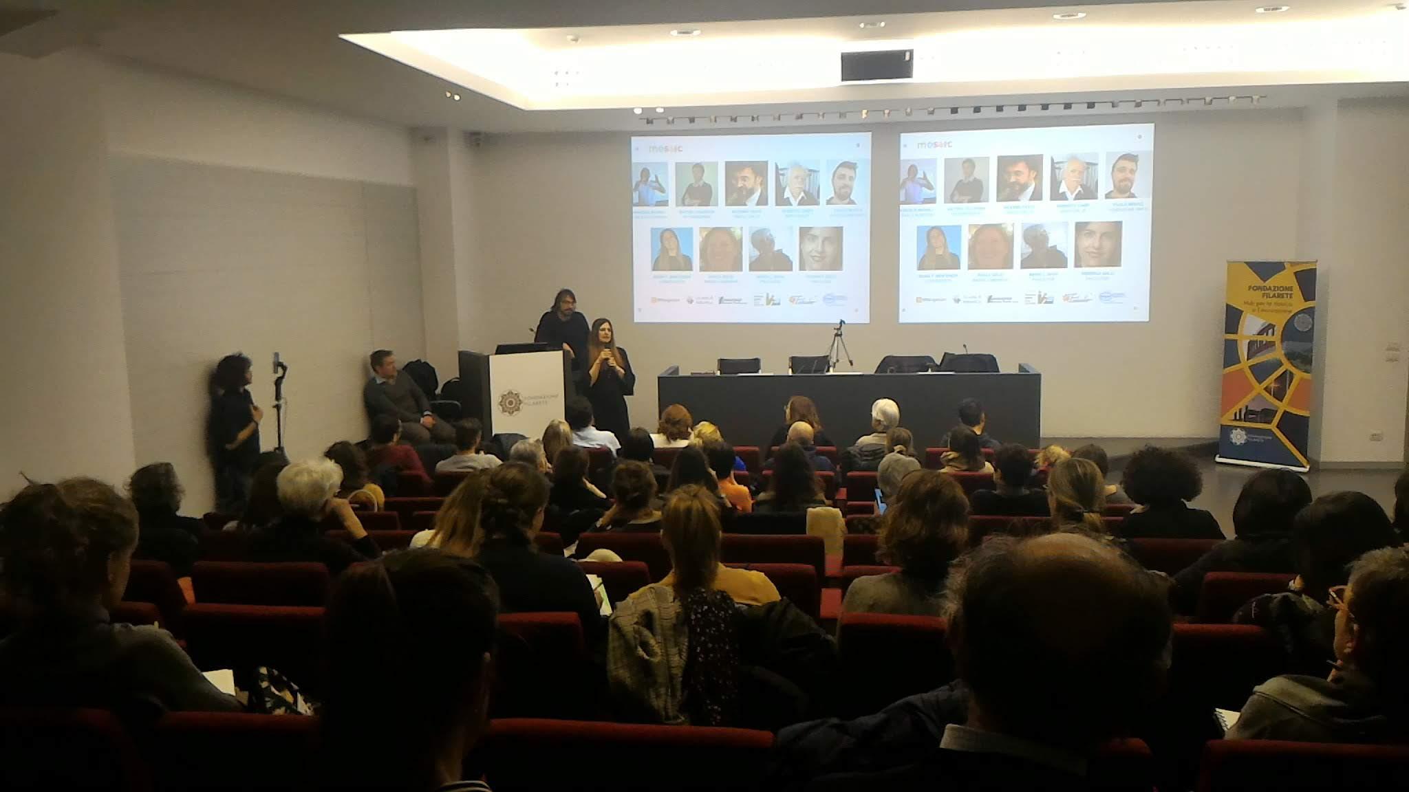 Evento di presentazione MOSAIC, la platea ascolta l'intervento di Maria Montuschi